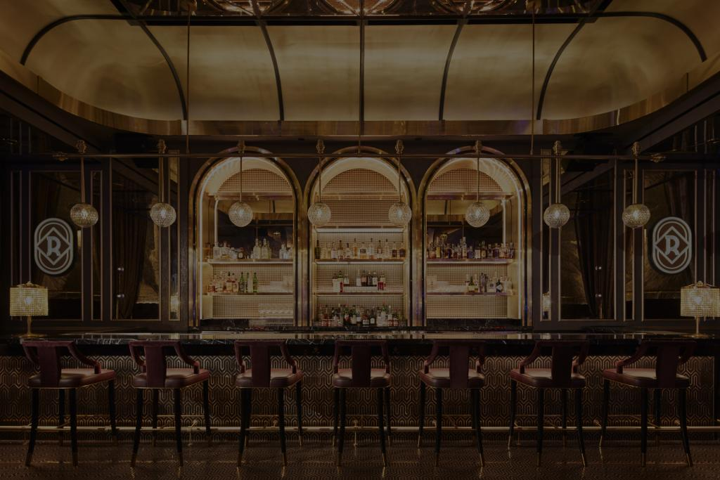 "Rosina: Identity, Signage, Menus <div class=""project_desc_copy"">	 <div class=""branding_desc""><strong>The Project:</strong> A discrete and intimate bar located on the casino floor of the Palazzo Hotel in Las Vegas.	</div> <div class=""branding_desc""><strong>Services:</strong> Concept, Brand Positioning, Naming, Logo & Identity, Collateral, Signage</div> <div class=""branding_desc""><strong>The Goal:</strong> To create a charming and intriguing destination bar that would offer an escape from the noise and energy of a Las Vegas casino.</div> <div class=""branding_desc""><strong>Our Solution:</strong> Our design drew from the muse of the envisioned character Rosina. The prohibition-era socialite who travelled often and lived well. Her luxurious lifestyle, well appointed living spaces and coyly seductive personality inspired the details of our design and narrative. Every piece of the brand was considered from the point of view of Rosina's tastes and inclinations.</div> </div> Las Vegas, NV"